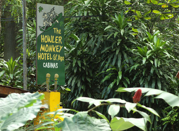 Howler Monkey Hotel sign and plants