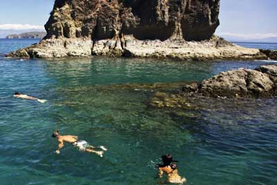 People snorkeling around Tortuga Island with Zuma Tours